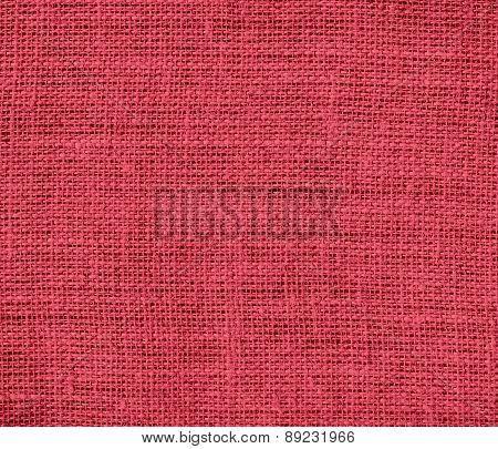 Brick red color burlap texture background