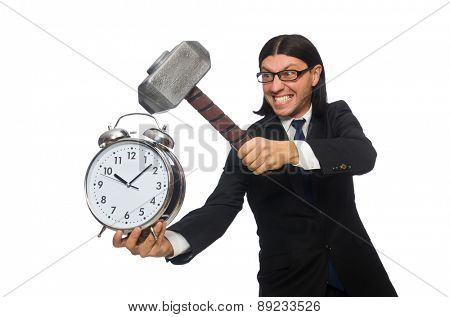 Handsome businessman holding hammer and alarm clock isolated on white