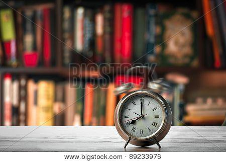 Alarm Clock On The Bookshelf