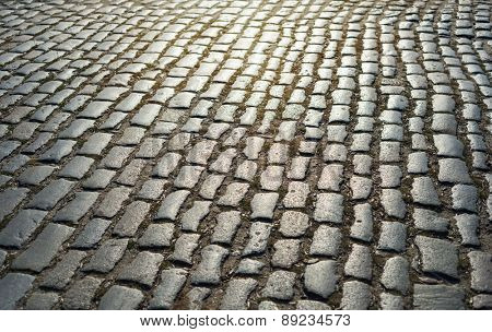 cobbled road as background on sunset