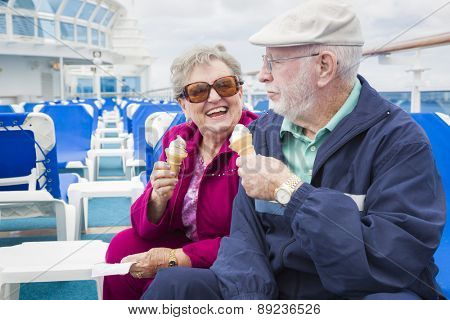 Happy Senior Couple Enjoying Ice Cream On The Deck of a Luxury Passenger Cruise Ship.