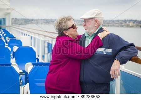 Happy Senior Couple Enjoying The View From Deck of a Luxury Passenger Cruise Ship.