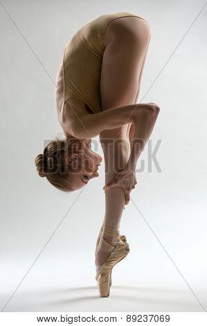 Fragile ballerina takes a deep slope forward