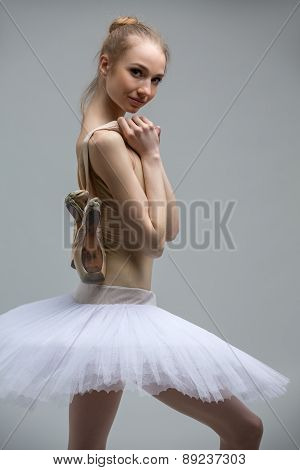 Portrait of young ballerina in white tutu