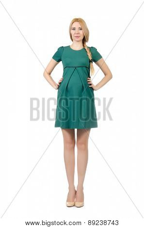 Beautiful pregnant woman in green dress isolated on white