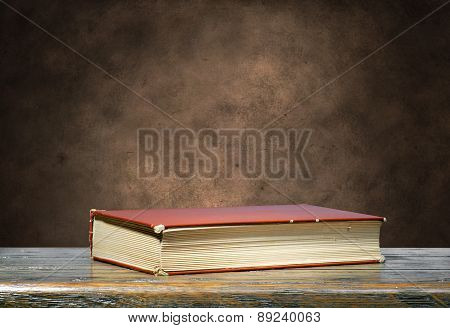 Brown Book On Brown Grunge Background
