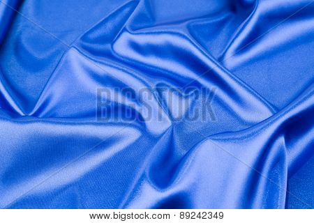 Blue silk background. Close up.