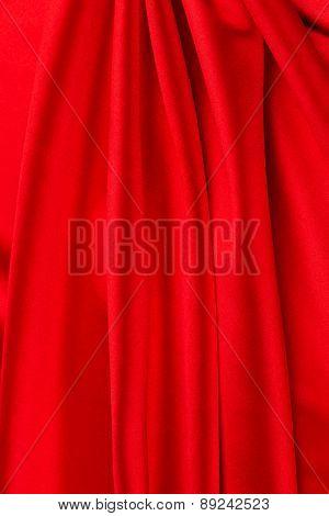 Red silk background.
