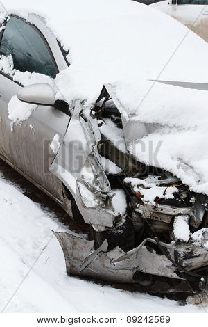 Crushed car in winter