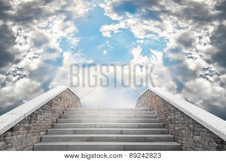Marble staircase leading to the cloudy sky