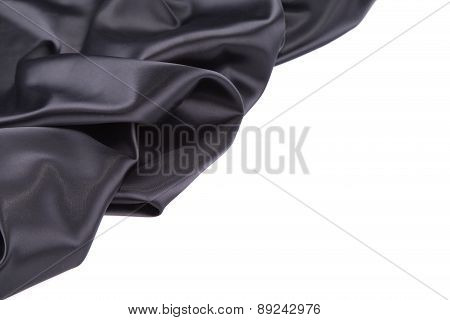 Black silk drapery. Close up.