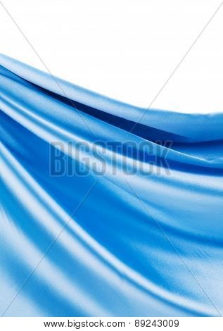 Creases in blue fabric. Place for text.