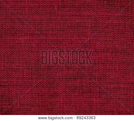 Burgundy color burlap texture background