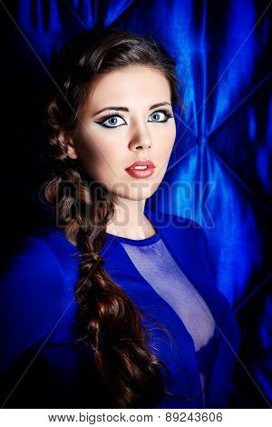 Portrait of young woman with beautiful big eyes. Make-up, cosmetics.