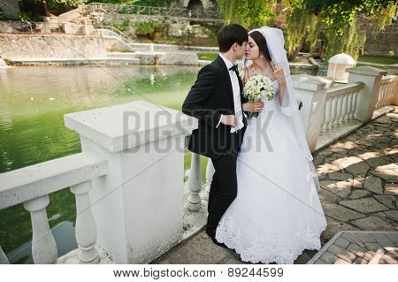 Young Beautiful Wedding Couple Near Lake