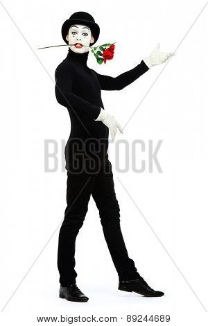 Full length portrait of a male mime artist with red rose performing different emotions. Isolated over white.