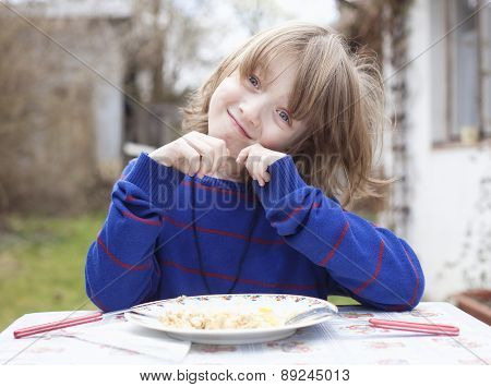 Boy Eating Outdoors