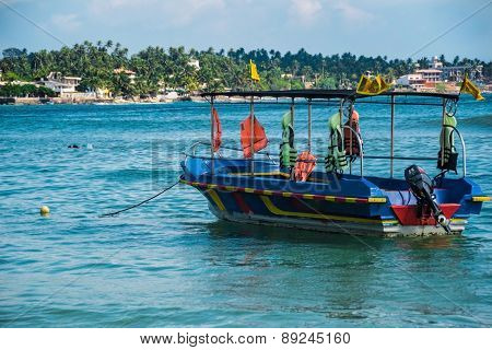 seascape with motor boat, sri lanka, unawatuna