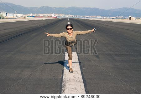 Happy Woman Imitating Airplane
