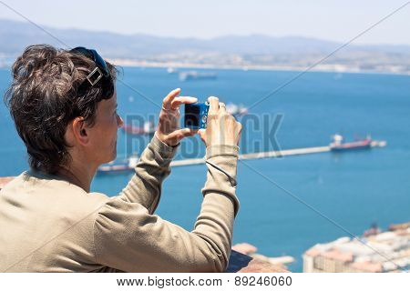 Woman Taking Photos With Compact Camera