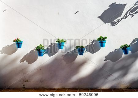 Blue Flower Pots On A Whitewashed Wall In Mijas