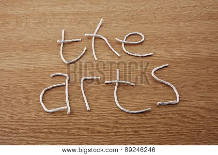 The Arts - Fun Style In String And Wood, Sign For The Arts.