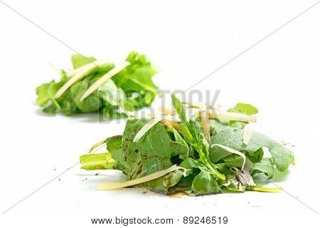 Heaps Of Rucola Salad With Parmesan And Balsamic Vinegar Isolated On White