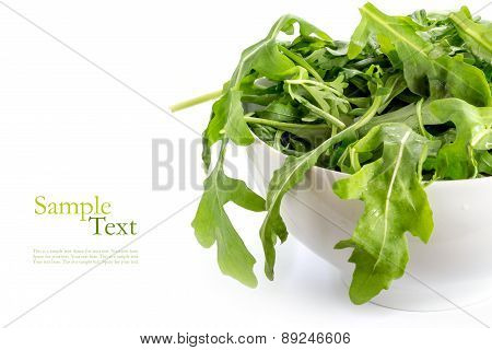 Rucola Or Arugula, Fresh Rocket Salad  In A White Ceramic Bowl, Isolated