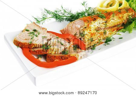 roast tuna fillet served on white ceramic plate