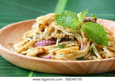Thai style Bamboo shoot  spicy salad on wooden plate