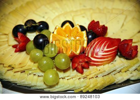 Platter Of Cheese Witth Various Fruits