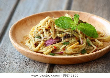Thai spicy Bamboo shoot salad on vintage wooden background