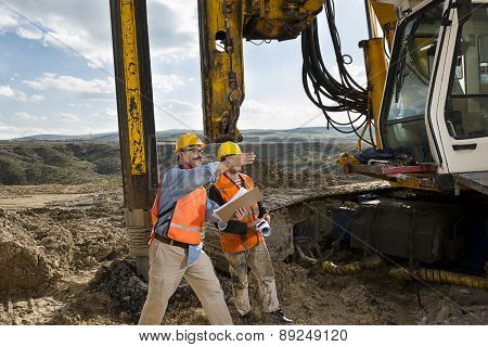 Mechanic engineer shows drilling pile foundation.