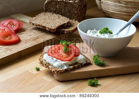 Curd Cheese Dip With Herbs And Rustic Wholegrain Bread With Tomatoes