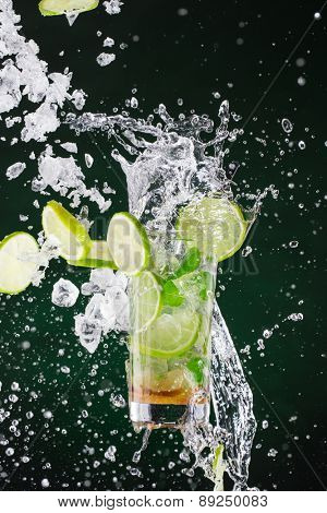 fresh mojito drink with liquid splash and drift, freeze motion.