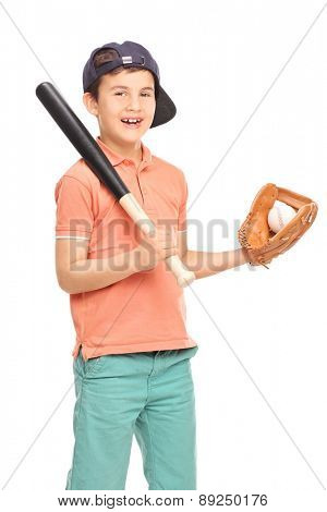 Vertical shot of a junior baseball player with a glove holding a bat and a ball and looking at the camera isolated on white background