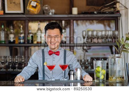 Smiling Asian bartender