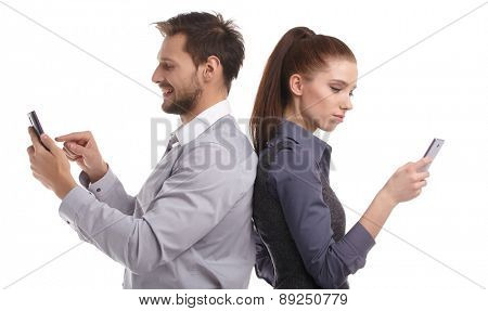Two persons too busy with their mobile phones