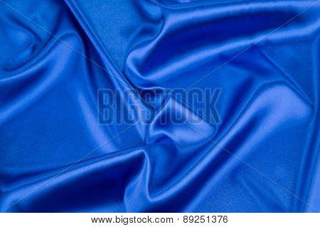 Blue silk background. Texture.