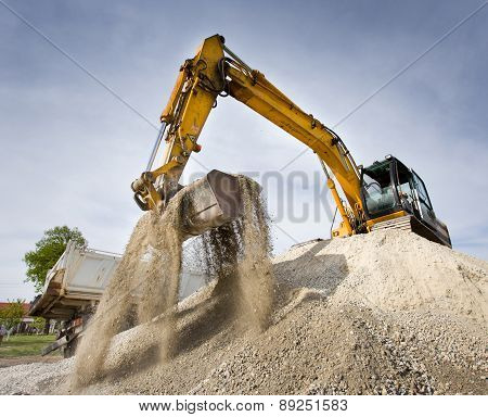 Excavator On The Gravel Pile