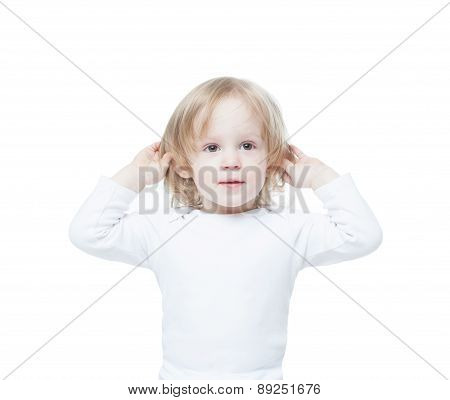 Baby little girl with long hair holding her ears, listening, isolation