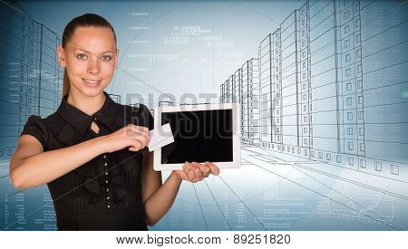 Young woman holging tablet and card