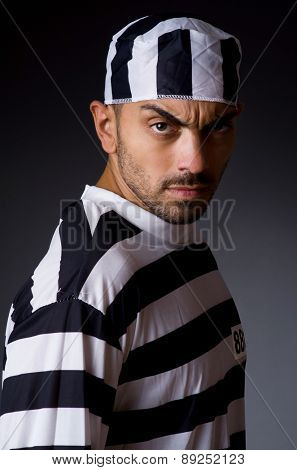 Angry prison inmate in dark room