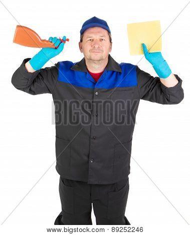 Worker holding spray bottles.