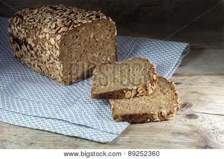 Bread Loaf With Whole Grain And Seed On Rustic Wood, Dark Background
