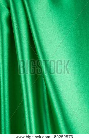 Green silk background.