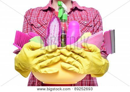 Lady holding basin with cleaning supplies.