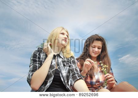 Girls Holding Field Summer Wild Flowers Bouquets And Guessing Chamomiles
