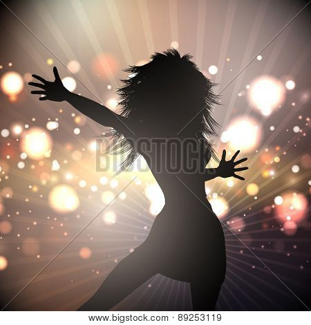 Silhouette of a female dancing on an abstract lights background
