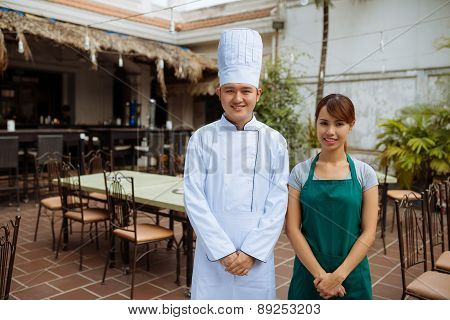 Asian chef and a waitress